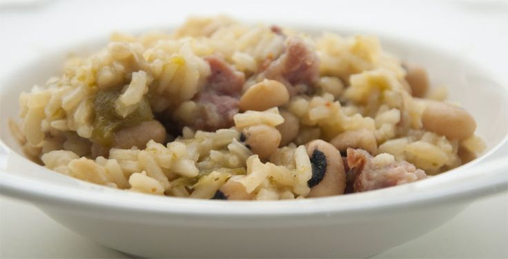 Hoppin' John is a bean, rice, and pork dish popular in coastal South Carolina and Georgia. It is still very popular among the Gullah on the Carolina coastal islands where Hoppin' John is served on New Year's Day for good luck and according to one tradition, a coin is added to the pot and whoever gets the coin will get rich.
