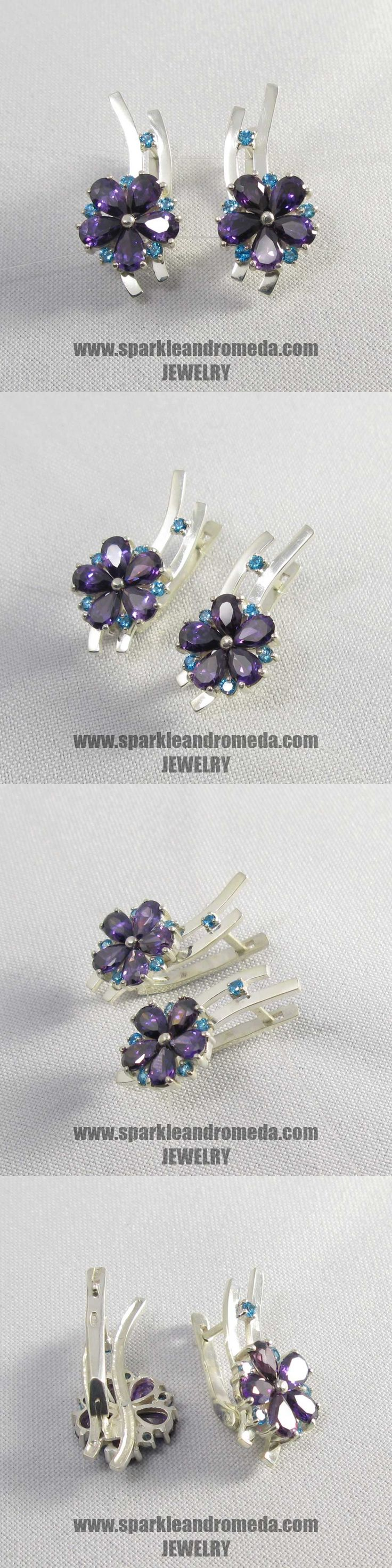 Sterling 925 silver earrings with 10 pear 6×4 mm violet amethyst color and 12 round 2 mm blue topaz color cubic zirconia gemstones.