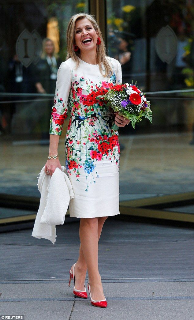 The red and white flowers in her bouquet coordinated perfectly with the print on her dress...