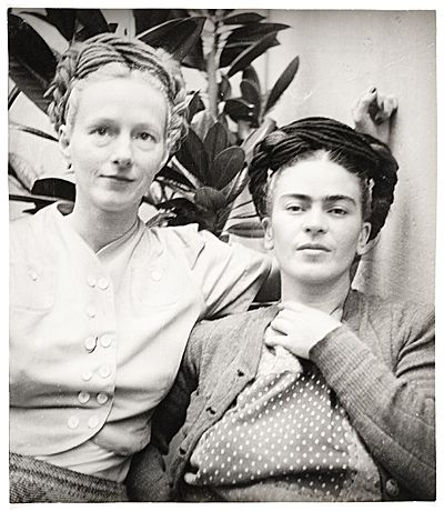 """* Emmy Lou Packard and Frida Kahlo, 1941 photo Diego Rivera Painter, printmaker and muralist Emmy Lou Packard (1914-1998) worked as Diego Rivera's assistant in the United States and lived in Mexico with the Riveras early in her career. Packard photographed the couple posing in the backyard of her famous """"Blue House"""" (now the Frida Kahlo Memorial Museum in Coyoacán, Mexico) where Kahlo was born, maintained a studio, and spent the last days of her life."""