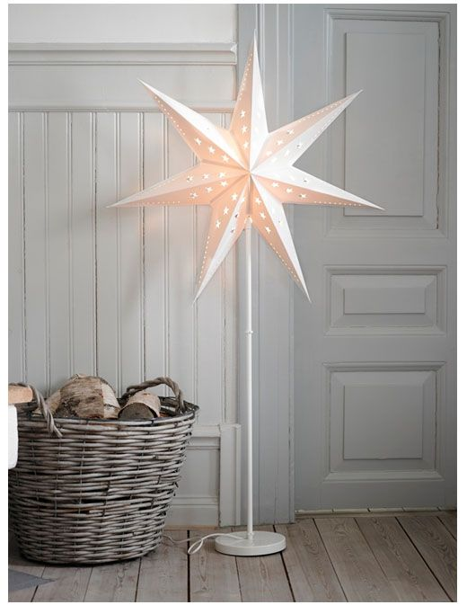 Star lantern over a lamp-beautiful! Spray paint black pipe on a stand for different heights.