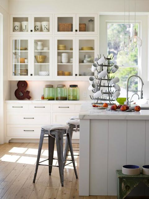 KITCHEN-- Love the glass uppers.  Love the natural light, white on white, and the dcorative details.