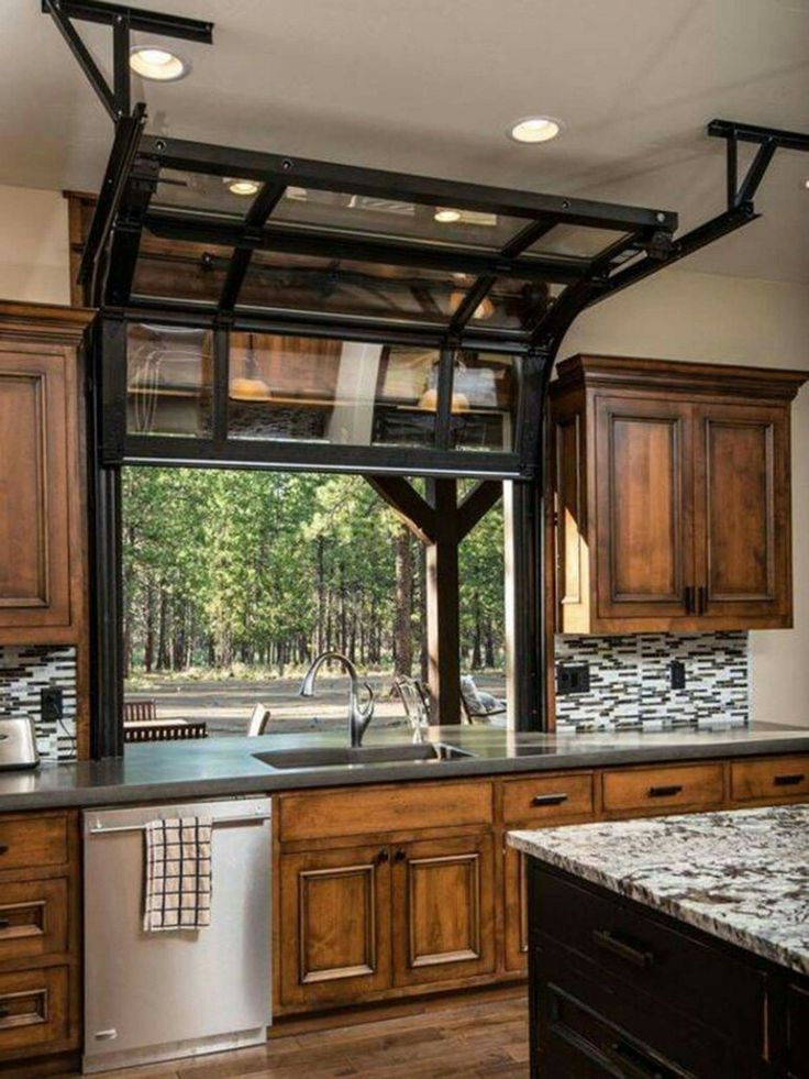 Garage door style window in the kitchen. Neat idea if you have an outdoor kitchen/patio