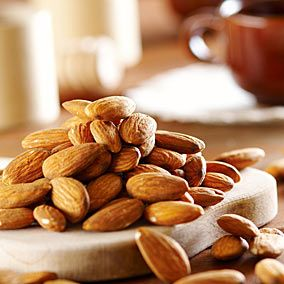 Almonds are a good source of fiber. One ounce contains only 167 calories, plus it packs roughly 6 g of protein and 3 g of fiber. Furthermore, almonds are crunchy and require a lot of chewing, so they, too, can make you feel like you've eaten more than you actually did and keep you fuller longer.