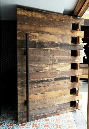 we love the combination of modern and rustic elements in this eclectic pivot door find