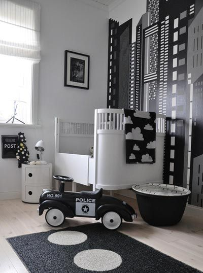 This #monochrome #nursery is fantastic, it creates a real twist on the typical #children's #nursery. Perfect for how quickly children grow, this funky #skyline #design could work right through to #teenage years.  #childrensbedroom #bedroom #nursery #crib #baby #kid #kidsbedroom #home www.rockmyroost.co.uk #homedecor #house #interior