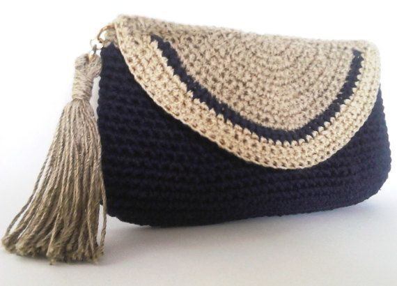 • Handmade item • Color: two shades of beige, something between dark purple and deep blue • Materials: cotton yarn , metal magnetic snap • Ships worldwide from Serbia, Europe. Designers notes: 100% hand crocheted clutch with cotton yarn. This item is designed using tapestry and single crochet . Magnetic snap closure. With inner lining and sponge. Sometimes you dont need to carry your entire life in a bag. For times when you just need the essentials, this Clutch is convenient. It can fit y...