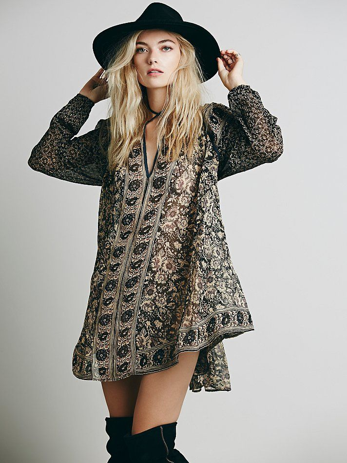This is a great modern look, that references retro designs. The shape and flow of the design make it very fashion forward. The lightweight fabric and use of paisleys make it incredibly similar to fashion from the 60's. Both the patters, and te overall vibe of the outfit correlate with what was popular during that time. -Marissa Smith
