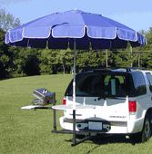 It's a table, it's an umbrella - it attaches to your trailer hitch. *love*