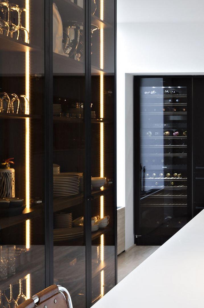 Liedssen kitchen interior. Dark glass cupboard doors. Interesting lighting for bar cabinetry.