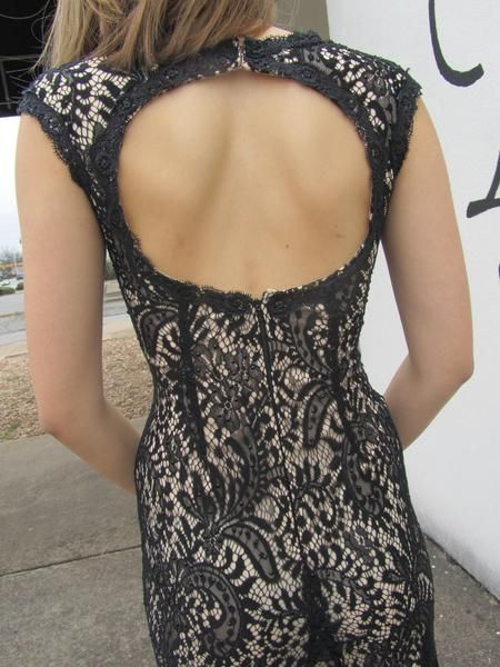 This vintage style gown in black lace is beautiful. Lucci Lu designed the perfect floor or ankle length gown, depending on height and shoes. The back features a