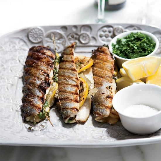 Lemon-Stuffed Grilled Branzino | Branzino, a European sea bass, is low in fat but has a wonderful richness when cooked on the bone. Barbara Lynch stuffs the fish with lemons and herbs, then grills it until the skin is browned and crispy to add even more flavor.