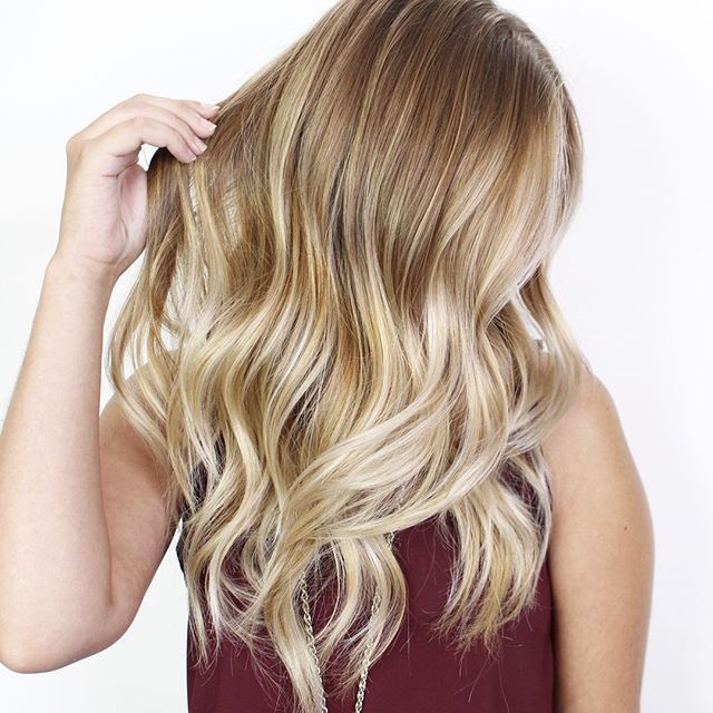 warm blonde balayage on long hair. beigey blonde and platinum blonde highlights
