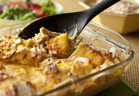 Slow Cooker Cheesy Chicken & Tortillas  Slow cooking the chicken before shredding makes it especially tender and flavorful...when that chicken is layered with tortillas and cheese, you've got a simple, family-friendly casserole.