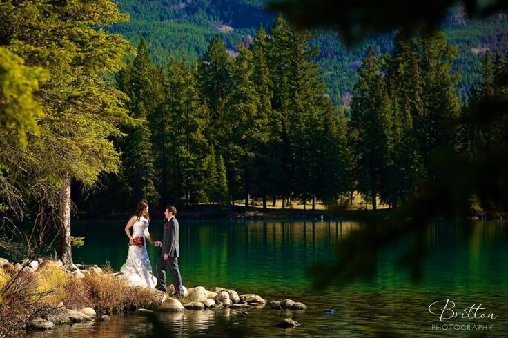Bride and Groom by the Lake in Jasper, Alberta.  Photo by Britton Photography.