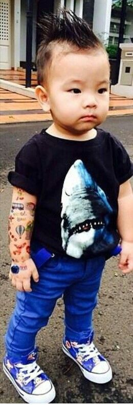 Awesome little boy style! Fake tattoos, Mohawk, cons, shark tee!  I think this is great representation of being who you are no matter where you came from or who you will become.