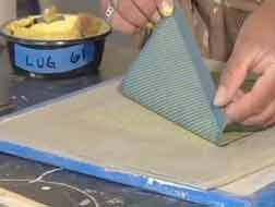 Paul Wandless doing screen printing onto clay, from the Ceramic Arts Daily Presents Screen Printing with Clay DVD.  This web page about the DVD contains two instructive video clips, plus a very useful overview: how to create screens for ceramic printing; how to print through the screens (including one over another, to create depth); how to turn underglazes into the same consistency as screen printing inks.