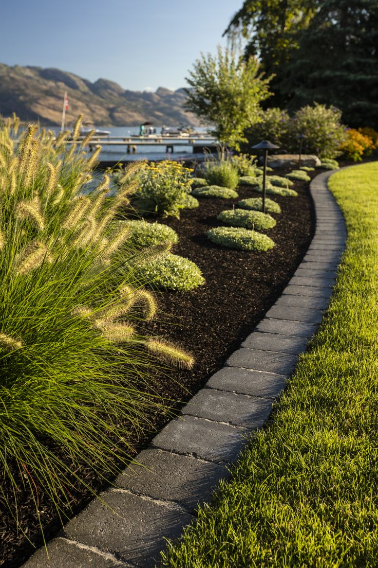 Use Roman pavers for edging or an accent to separate spaces in your backyard landscape.
