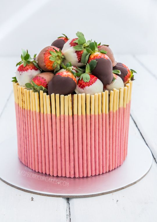 strawberry milk pocky cake with chocolate-dipped strawberries.