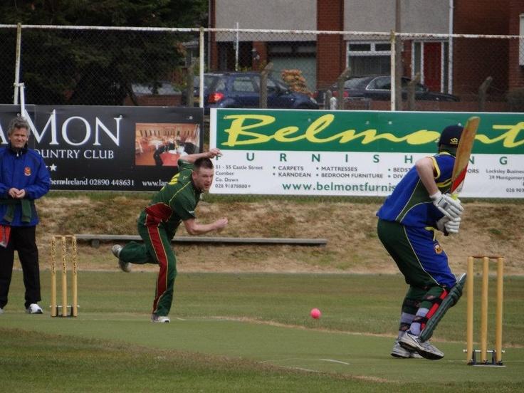 Dominic Joyce of Merrion opens the bowling against @Robert Duggan