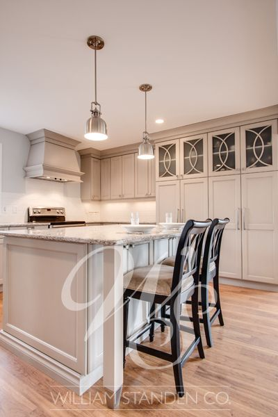 Custom grey painted kitchen Warm grey custom cabinets with oyster