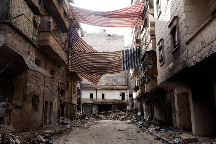 Franco Pagetti—VII:  Syria, 2013.  Curtains and drapes, hung along the streets of the Syrian city of Aleppo, act as veils for the city's residents, providing safe passage from the snipers throughout the city.    Read more: http://lightbox.time.com/2013/04/08/the-veils-of-aleppo-photographs-by-franco-pagetti/#ixzz2PuaU2IYq