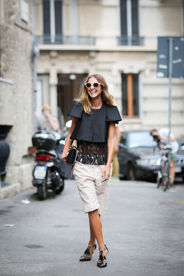 How To Dress Like An Italian Girl — 50+ Lessons Worth Knowing #refinery29  http://www.refinery29.com/2014/09/74945/milan-fashion-week-2014-street-style#slide8  Have you ever seen Bermuda shorts look so glamorous?