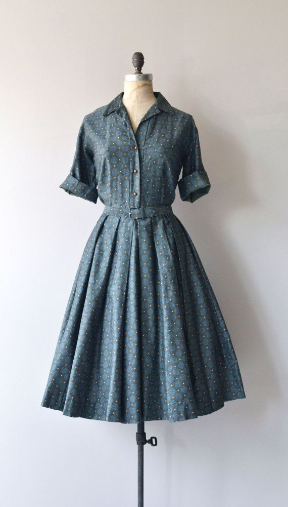 Cuffed sleeves and self fabric belt...and that 1950s skirt