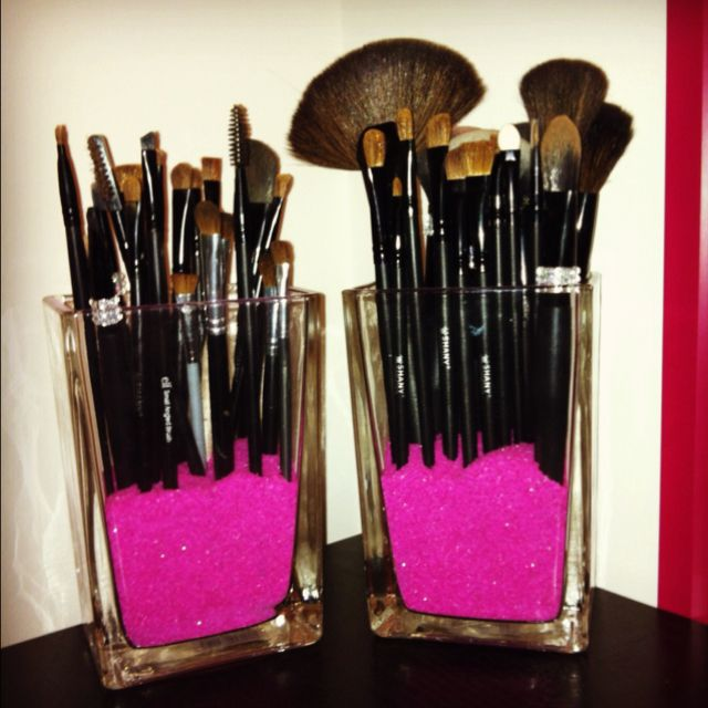 Make up brushes in colored sand.. Cute, organized idea.