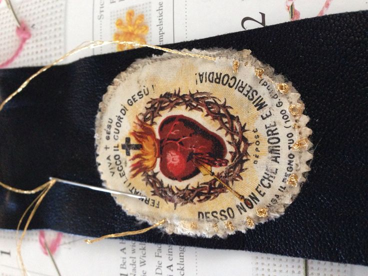 Embroidering an antique rscapular on a leather bracelet