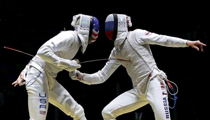 Face to face:    The United States' Miles Chamley-Watson, left, competes against Artur Akhmatkhuzin of Russia in the men's foil individual table at Carioca Arena 3 on Aug. 7.