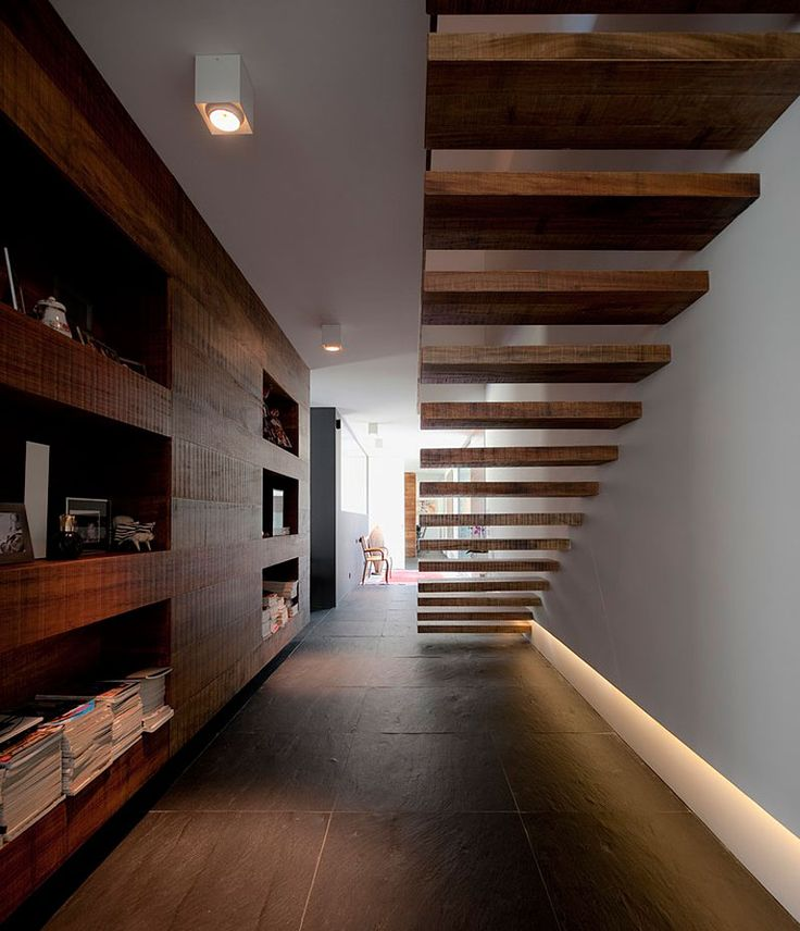 Minimalist Staircase and gorgeous built-ins