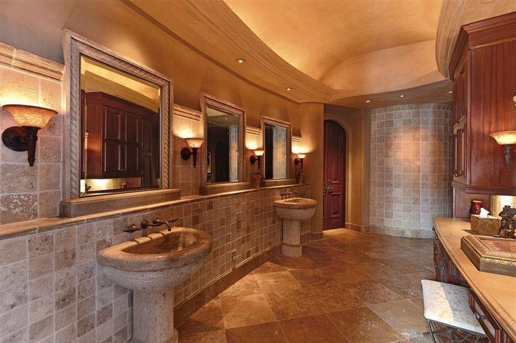 Mediterranean Master Bathroom with Panaria Vitality, Wall sconce, Built-in bookshelf, travertine tile floors, French doors