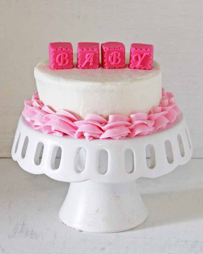 Enter to win your very own mold to make a cake like this pretty Baby Blocks Cake!   http://cakejournal.com/giveaways/alphabet-blocks-chocolate-mold/