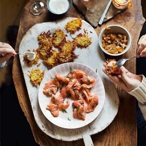 Quick-cured salmon with caramelised apples and mini röstis. You'll need top-quality salmon for this recipe, served with röstis and caramelised apples.