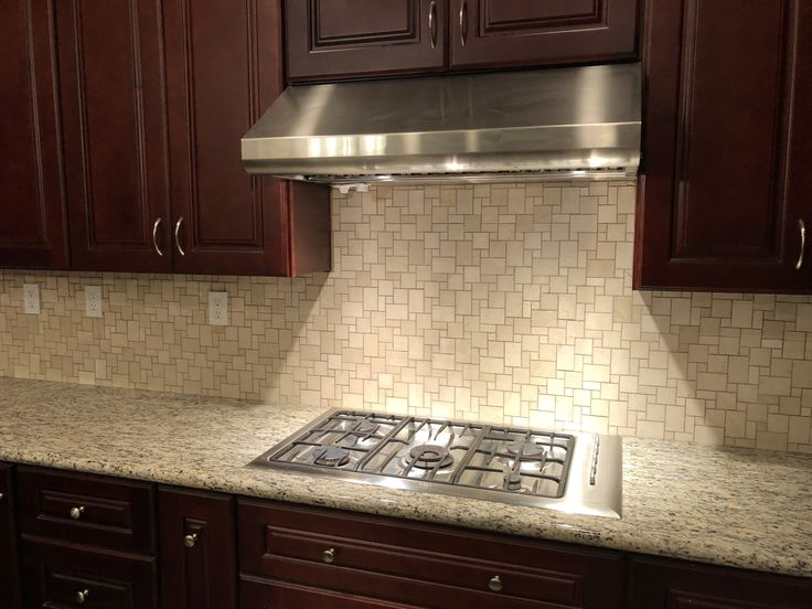 Versailles backsplash with cherry cabinets and St Cecelia light granite