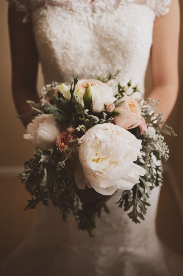 Wedding bouquet David Austin roses peonies dusty miller. Baby's breath.