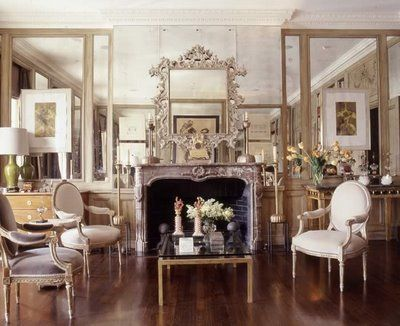 I definitely want to flank each side of my fireplace with mirrors! Beautiful!