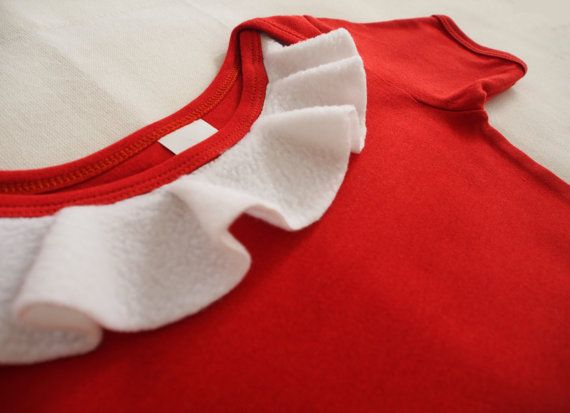This unique onesie is perfect for Christmas with white fleece frills. Mrs Claus Onesie by keb4kids on Etsy