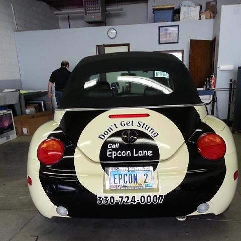 Here is the same custom vehicle wrap for the pest control company Epcon Lane from the back. Imagine sitting in traffic - you definitely know what they do and if you need help with bugs - you'll be jotting down their number.