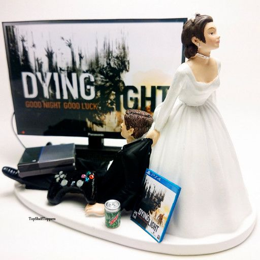 """*FREE** Customizations include the following: (add in the notes section when purchasing) *Bride hair color *Groom hair color *Any beverage of your choice , *Your Choice of a video game or sports team. *Add/Remove Wedding Veil This Custom Wedding Cake Topper is perfect for the gamer in your life. *I can change the game to anything you want :) Cake Topper Measures from Base Length 5.5"""", Width 3"""", Height 4"""" *Returns are welcome if the item was damaged due to shipping I ..."""