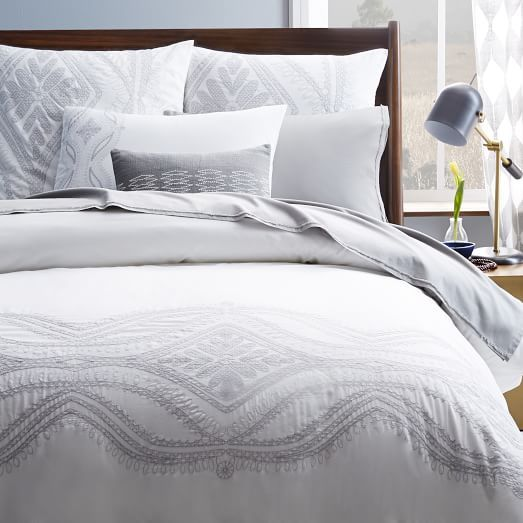 Crafted from 100% cotton, the Maroc Duvet features a placed embroidery of Moroccan-inspired waves and diamonds.