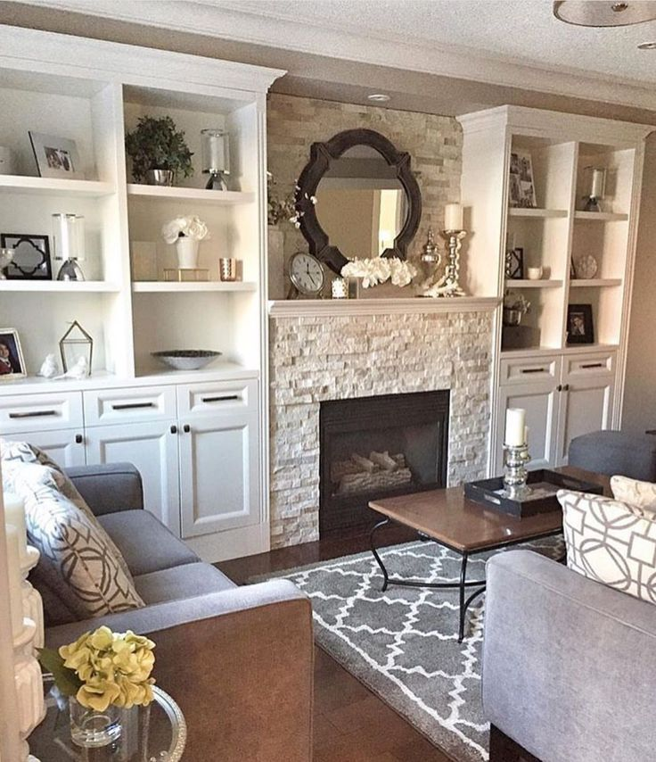 Getting It Right With A Cosy Living Room: Farmhouse White Cabinents With Stone Fireplace- Cozy