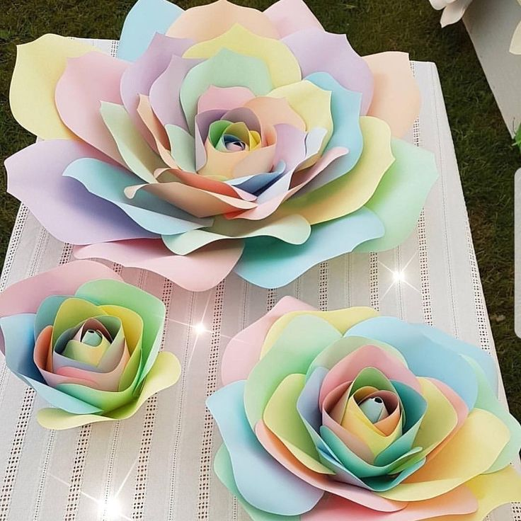 """3 sizes of my giant unicorn paper roses for sale large is 26"""" wide £25 medium 12.5"""" £15 small 9"""" £8 plus delivery #unicorns #giantpaperflowers #unicorn #partyideas #kidspartys #girlsbirthday"""