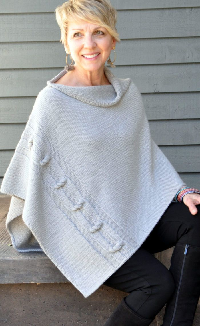 Knitting Pattern for Knotted Chain Poncho - This classic poncho with innovate 3-D detail is knit bottom-up in a single rectangular piece with no provisional cast-on, no cable needle, no grafting and no sewing. DK weight. Designed byRonnie Eldridge