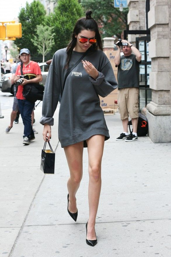 Kendall Jenner steps out in a sweatshirt as a dress, black pointed toe heels, and aviator sunglasses.
