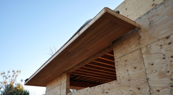 This is another look at the soffit but if you are observant, you will notice the gap at the right hand side. This gap is in place to allow the passage of the stone veneer up and through where the soffit is located. This is a cleaner detail than framing the soffit all the way back to the sheathing (plywood) and then having a new flashing condition.