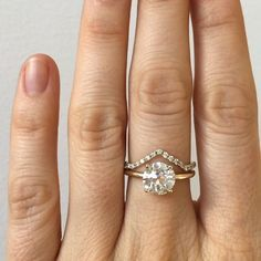 Simple and pretty. Custom engagement ring featuring a 1.94 carat old European cut white diamond, prong set in 14k yellow gold. I paired it with my favorite Shape Band- the Mini Peak with white diamond micro pave. If you're interested in creating a custom piece email @mailto:custom@mociun.com /search/?q=%23mociun&rs=hashtag /search/?q=%23mociuncustom&rs=hashtag /search/?q=%23mociunjewelry&rs=hashtag /explore/diamonds/