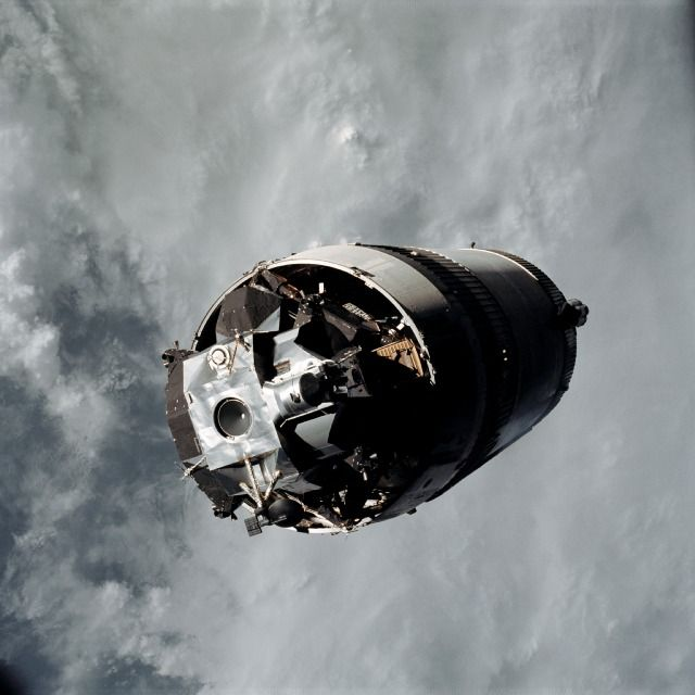 """Apollo 9's """"Spider"""" lunar module lies nestled in the third stage of the Saturn V rocket that carried it to space in March 1969."""