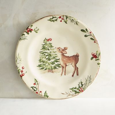 Featuring a deer nibbling at an evergreen, our salad plate coordinates beautifully with our heirloom-worthy Winter's Wonder pattern. Crafted of solid ironstone, it features a border of holiday greenery and red holly berries.
